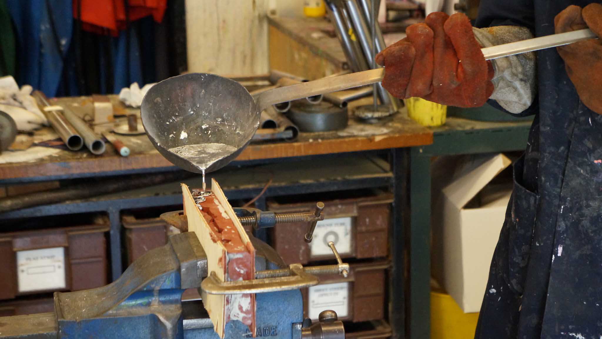 KEVICC student Mason pours liquid metal into his pewter arrowhead cast