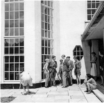 The Dartington Film Unit filming inside Foxhole courtyard, around 1939. (c) Andrew Hunter