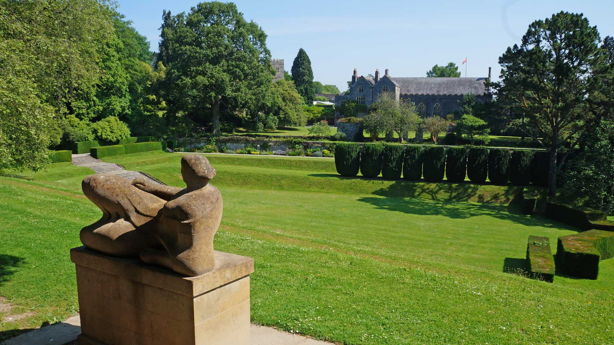 Dartington Hall's Tiltyard area, with Henry Moore's Reclining figure sculpture in the foreground and Great Hall in the background