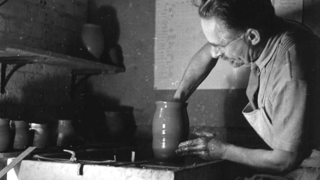 Bernard Leach in his studio