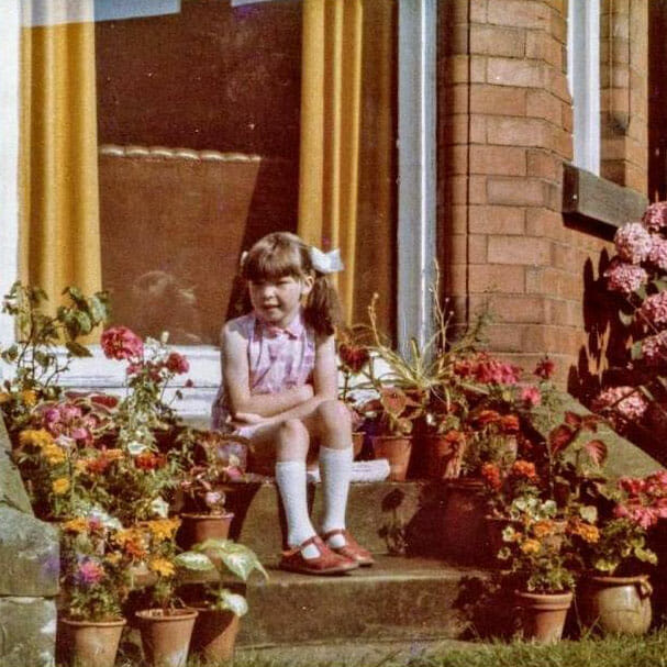 Sarah Coates as a child in her Nottinghamshire family garden